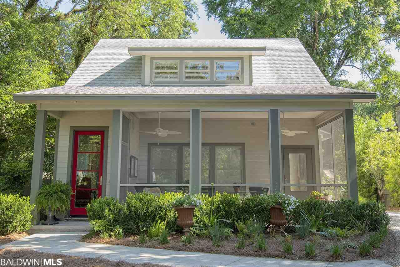 This house is located in the perfect spot to enjoy all Fairhope has to offer.  It is a block from the bay and downtown Fairhope as well.  The house has a roomy 2 car garage and separate living area above.  Huge Front porch and lots of windows.  This is an entertainers DREAM.
