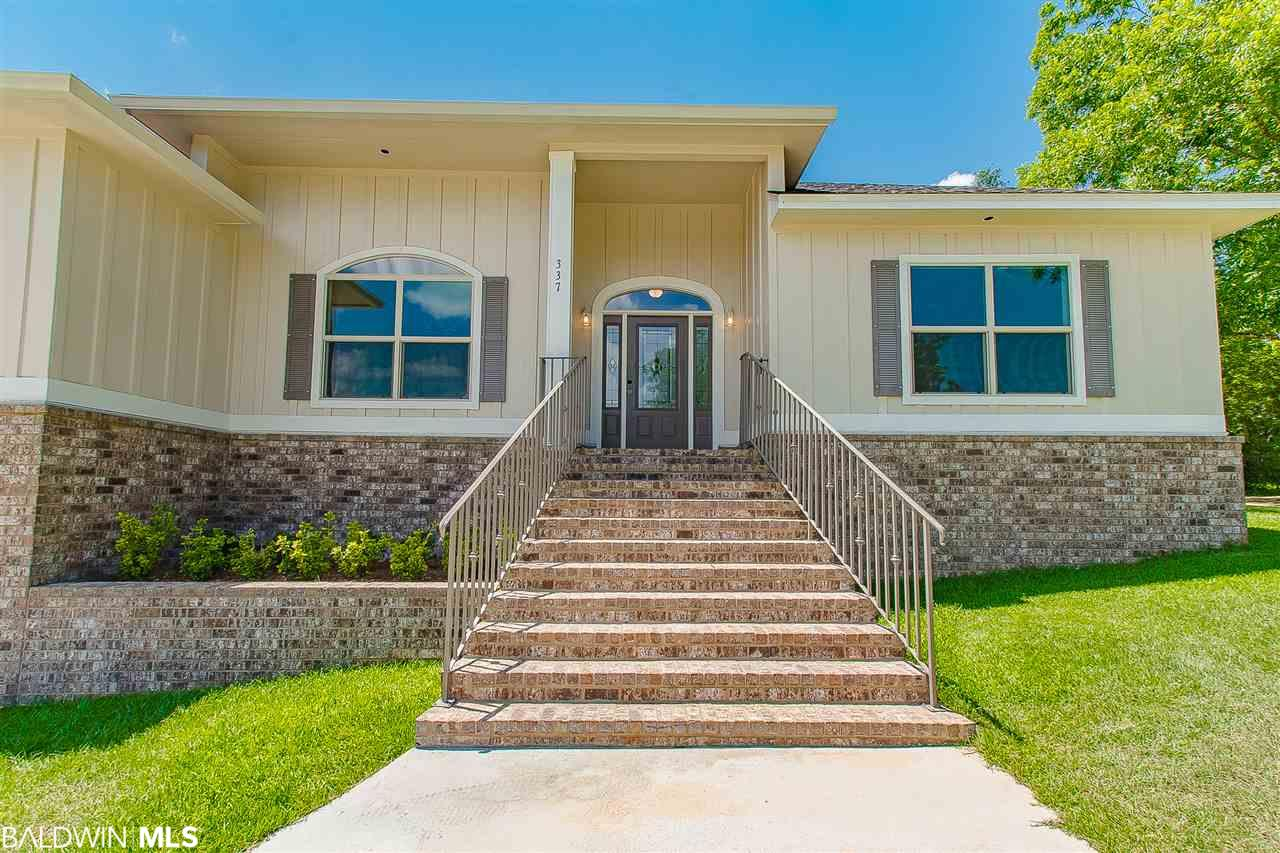 Have the best of both worlds, the convenience of town with the beauty of the country. This GOLD FORTIFIED 4 bedroom, three bath house stands out. It's located in an ideal Fairhope neighborhood with nothing but beautiful custom homes. Oak trees line the backyard. The entryway will impress with its elegants staircase and partitioned garden. Inside you'll have space to grow. Essentially this property boasts two master suites along with two additional bedrooms. You want a chandelier in your walk in closets? In that case, you've got room in this master suite. Custom cabinetry in the kitchen along with an extended mosaic tile backsplash. Under counter stainless double sink, granite countertops, and a walk-in pantry. Cabinetry in the utility room for extra storage. Wide planked flooring throughout common areas. Ceramic tile in kitchen and bathrooms. Enjoy coffee on your covered brick patio. Unique design, space, comfort, convenience, and beauty in the heart of Fairhope.