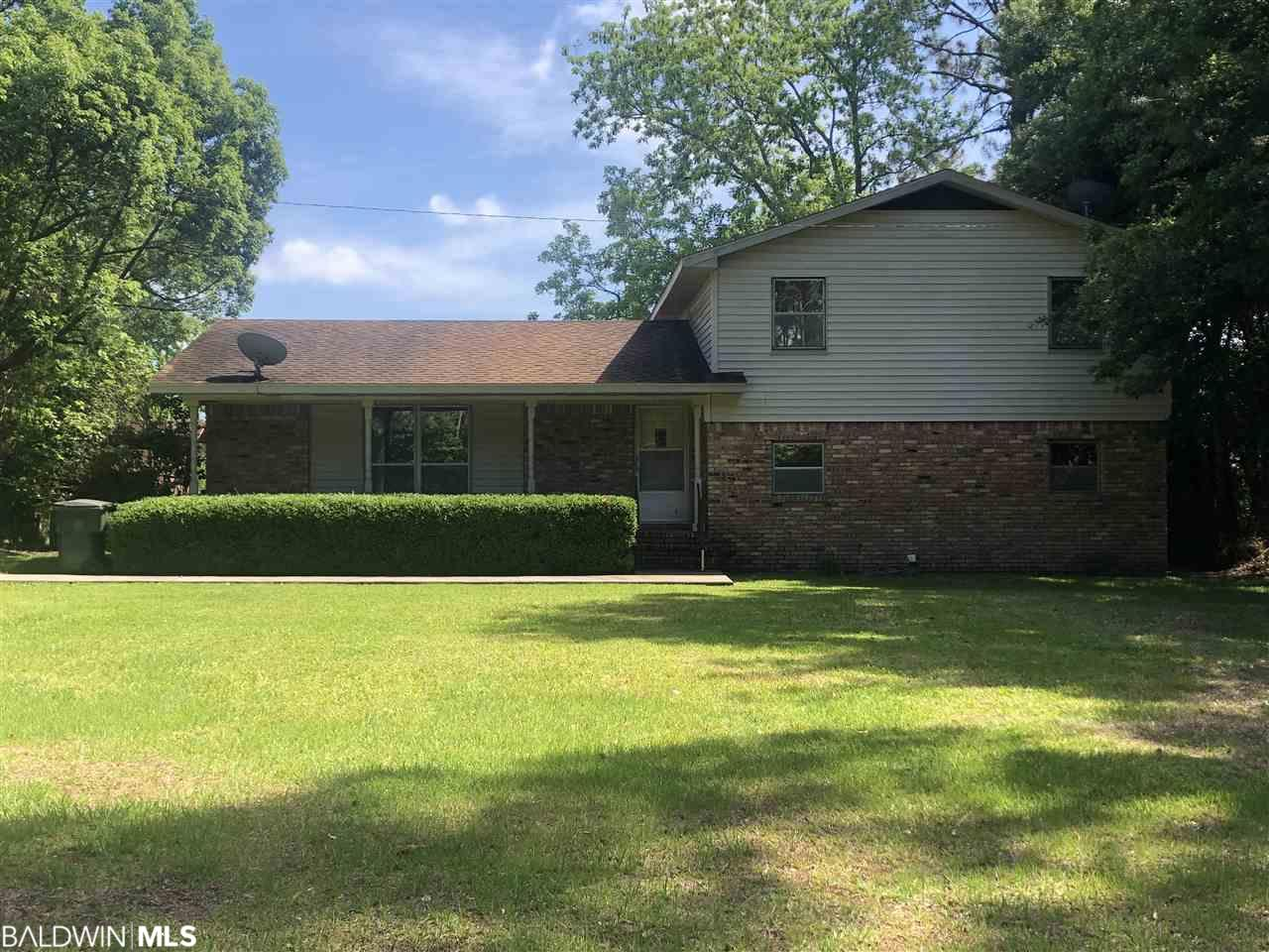 """This house sits on almost an acre of land and is 1/2 mile from HWY 59. Lower level could be used for a mother-in-law suite or multi-generational area. House is sold """"as sold where is""""."""