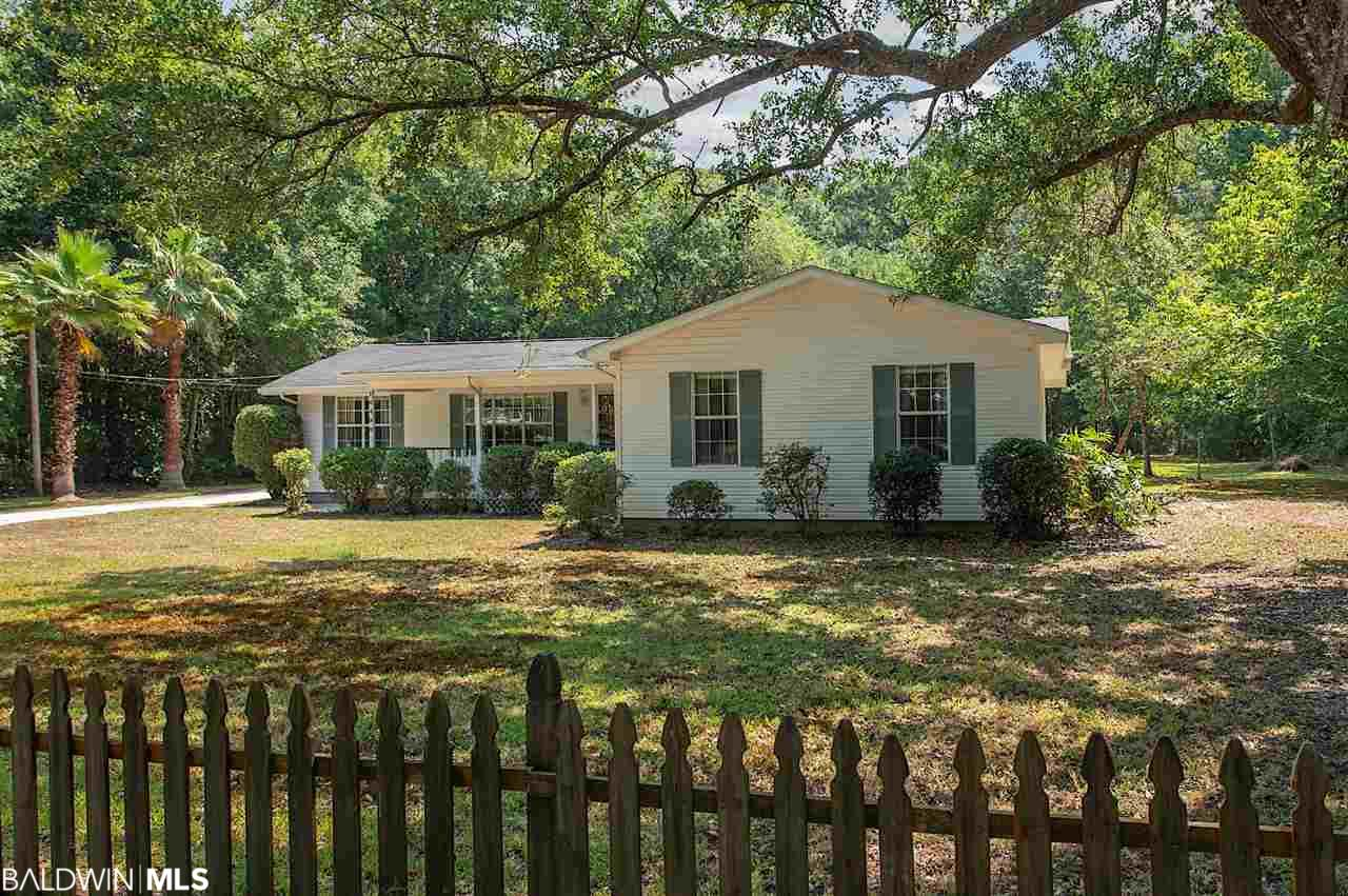 Incredible opportunity to own a piece of Point Clear history! This charming and spacious cottage sits on 5.7 gorgeous acres across the street from Mobile Bay.  Perfect for entertaining or vacationing, this adorable home offers 3 bedrooms, 2 full bathrooms and a huge rec room.  The rec room bonus space features 2 full walls of windows bringing the outdoors in and flooding the space with natural light.  The oversized master suite is the perfect retreat! Featuring granite and a jetted tub in the bathroom, a generous walk in closet and additional laundry space.  This beautiful property also boasts majestic live oaks, mature palms and hearty blueberry bushes.  Enjoy this private sanctuary from the backyard gazebo or take in the bay breezes from the large front porch.  When you're ready to escape the southern heat, cool off inside with the brand new HVAC system. A short walk or bike ride to The Grand Hotel and all that downtown Fairhope has to offer, makes this the perfect location to call home or spend your summers.