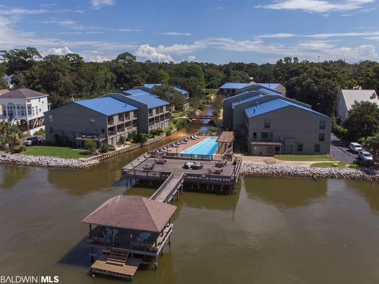 Relax by the pool and enjoy the pier. Enjoy the view from your covered balcony. Walk & bike to the many parks and piers. Close to Downtown Fairhope shopping and dining. Common amenities include a large gated salt water pool with showers and a bathroom. Spacious bedrooms with private bathrooms are on the top level with oversize closets. Monthly dues cover the common area insurance, termite, pest coverage, flood insurance, landscaping, city water, trash, sewer, management fees and reserve funds.