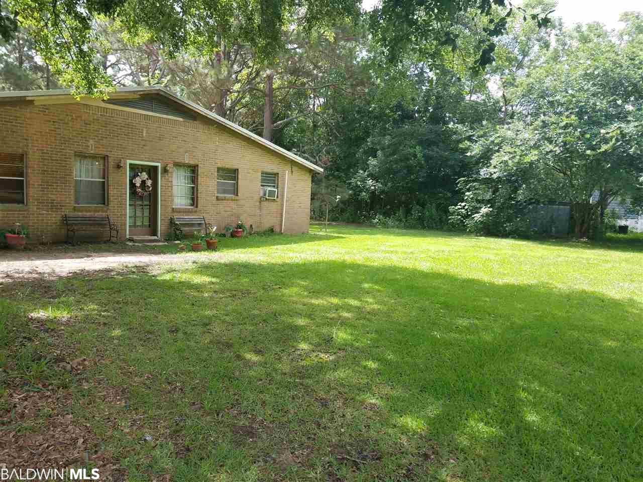 The possibilities are endless for this Robertsdale home on 1.5 acres.  Centrally located in the heart of Baldwin County between 59 and the Beach Expressway. This spacious home offers the perfect opportunity for those wanting a fixer upper.  This property also includes a large metal workshop.