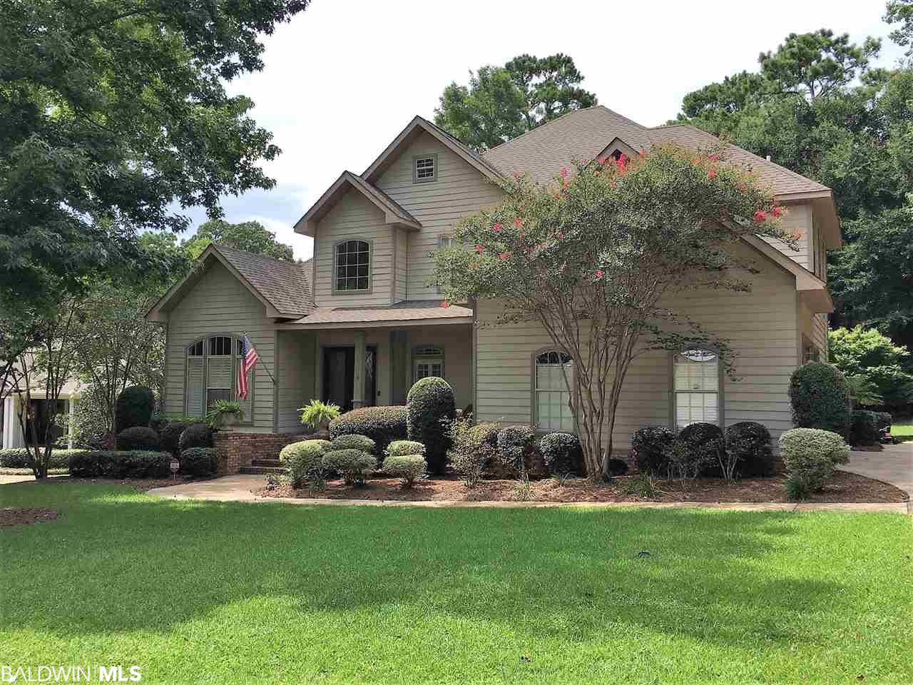 "It is all in the details.  Bay side of Olde' Daphne. Walk to the Bay.  This custom designed & built home is embraced by sweeping oaks & magnolias. Located on a quiet cul de sac with a small enclave of custom built homes. Cement board & brick facade.  A flat back yard that backs up to natural green space.  Put in a pool. 10X10 pergola with a tin roof and twinkle lights to listen to the beauty and peace of nature.  Back yard also has a covered porch and elevated deck for entertaining. Vines of jasmine wrap around the deck railing.  The front porch has a covered seating area.  Chicago brick columns & steps. Double custom mahogany & leaded glass doors great your guests. Front and back grand staircases is the wow factor you have been waiting for. Grand Foyer with soaring 20' ceiling.  Library/office and formal dining room.  Take notice of the wainscotting. Great room is centered by a gas fireplace and flanked by double french doors with transoms to your outdoor back space.  Morning room overlooks the garden.  Stainless kitchen with gas stove.  Large center island and a coffee and beverage station area.  2 large pantries.  Half bath located near oversized laundry room with soak sink.  Plenty of room for additional fridge & freezer.  Large master bedroom with en suite and sitting area. French doors to the outside back yard space.  10x12 master closet with built ins. Sep. tile shower with soak tub and privacy room.  Back stairway leads to a play area or computer room upstairs.  Large bonus room with built in children craft bar.  2 large bedrooms with en suite and additional bedroom & bathroom complete this area.  Lots of under stair storage & closets. 4"" scraped floors and tile in wet areas on first floor.  Whole house generator, and irrigation system,  Garage has epoxy floors.  This home is ""move in ready."""