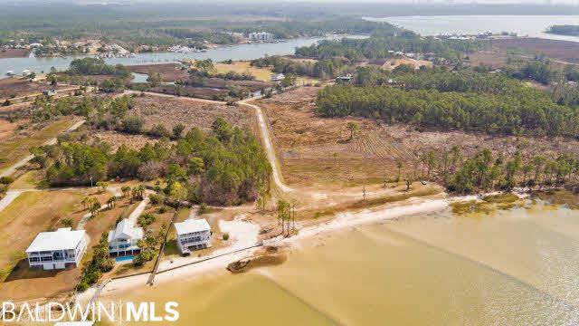 "Three Lots,  PERMIT FOR DREDGING ...Over 400 feet of Direct Water Front,  NO RESTRICTIONS!! Very PRIME Property, Luxury Waterfront!! ""They just aren't making more of it."" This sophisticated beautiful "" 425' +/- of Direct open Waterfront along the coast of Bon Secure Bay,  Intercostal Water Way and Gulf of Mexico, located on desirable Plash Island, Gulf Shores AL. Unobstructed heart-stirring and incredible water views.  Exceptional investment!  No type of building restrictions, commercial or residential! Use your imagination, not restricted,use as rental or build to sale would be ideal! A extraordinary large home can be built, make it your own private paradise, include a guest house, build an outside entertainment area that would be fabulous and one of its kind in this area. Build pier and boat doc and slips.  NO restrictions. Fishing, boating, paddle boarding, jet ski, kayaking and more.  Easy few minutes drive or boat to the beautiful white sandy beaches! This property is very close proximity to all the amazing attractions like the new OWA Waterpark , Tanger Outlet Mall, Infamous LuLu's , Tacky Jacks and The Wharf just to name a few.  Minutes by car or boat to tons of shops, other famous restaurants and all types of entertainment..  This property is an avid boaters paradise and a great Investment opportunity!"