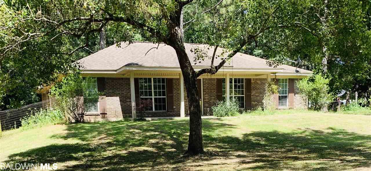 Mature shade trees make the front and backyard inviting! Spacious kitchen with an open concept. Split floor plan with a garden tub and stand up shower in the master. Walk in closets! Built in fire pit and goldfish pond in the backyard. Storage shed with power. Partially fenced back yard. Great location for commuting to Pensacola or Mobile!