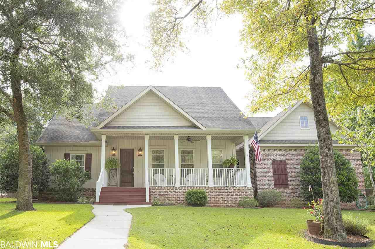 Just what you've been waiting for to beat the heat!  A gorgeous four bedroom three bath immaculate home with gleaming wood flooring. Enjoy the screened in porch overlooking the beautiful gunite pool that is also heated for year round enjoyment.  All the bells and whistles for the family including open floor plan,  living area gas log fireplace, split bedroom plan, cook's kitchen with lots of cabinets and granite countertops, gas cooking.  All appliances remain.  Private master ensuite with walk in shower and soaking tub. Lots of closet space.  Trane heat pump has 3 thermostats. 3 Spacious bedrooms downstairs. A private bedroom upstairs has its own full bath and closet.  Some attic storage.  Two car garage.  Quail Creek Estates is a golf course community and course is owned by city of Fairhope.  Tennis and pool optional memberships available.  Architectural committee active and restrictive covenants in place.  Builder, Prestige Dev. LLC in Fairhope.
