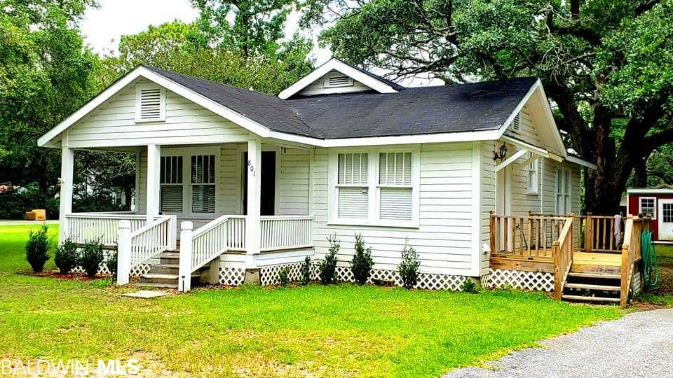 Investors and first time home buyers... check this out! Grab this super cute 2/1 bath on a nearly 1/2 acre lot! Situated among majestic oaks, this home features approximately 900 sf, 2 bedrooms, 1 bath, open kitchen, spacious living room, storage building, new deck, covered porch and 2 lots! Perfect for a rental or first home! Priced to sell!