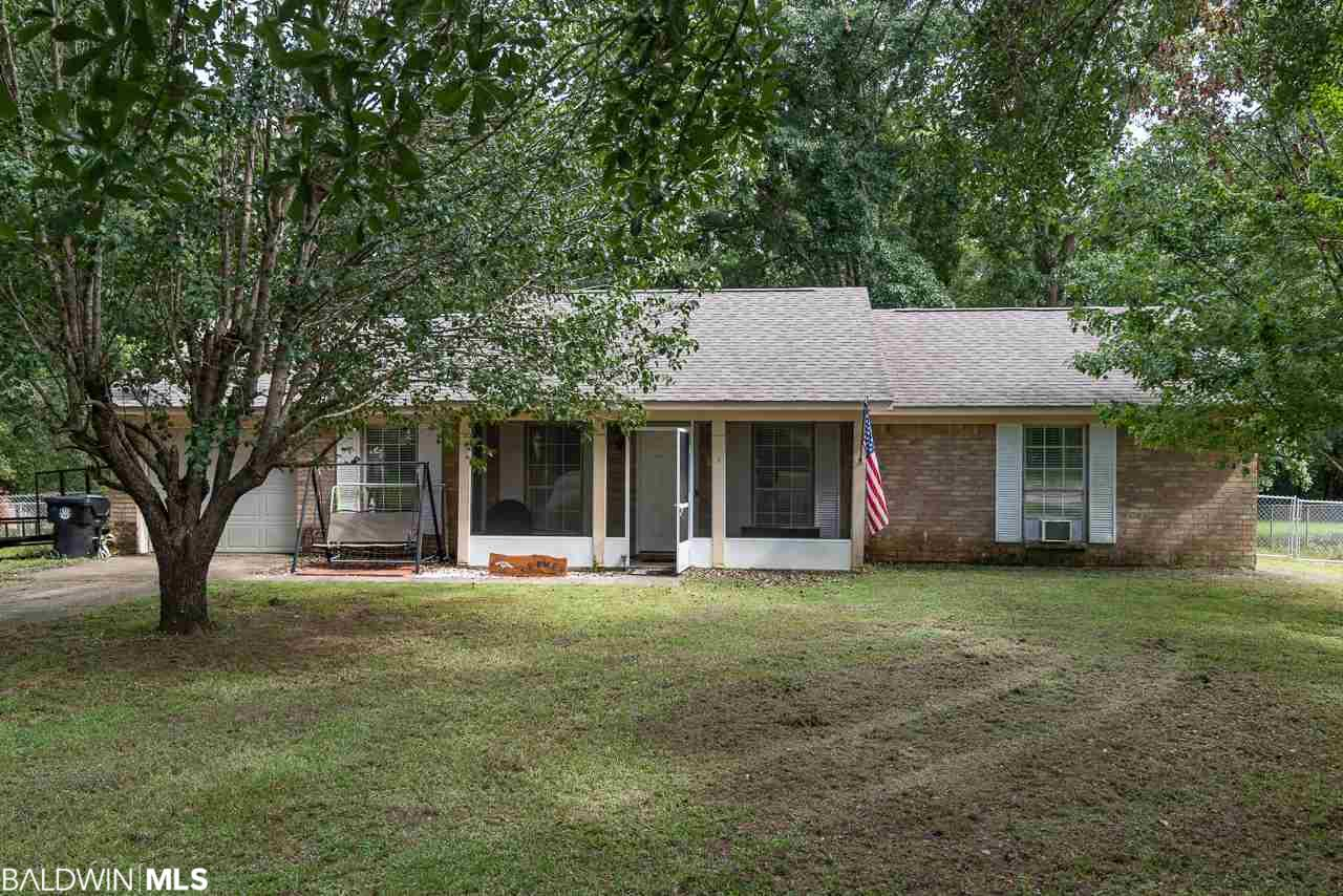 Welcome Home!!!!  This adorable 3/2 home is conveniently located behind the Robertsdale Elementary School!! The home sits on just under a half acre with mature trees and a stream that runs behind the property! The kitchen comes equipped with new countertops and plenty of cabinetry, a dining room right off of the kitchen, and an open living room for all your entertaining needs!! New carpet in all the bedrooms and hallway along with tile throughout the rest of the living area!!  This home has made so many memories for this family and they are ready to pass on for another amazing family to enjoy!!  This is a must see!!!