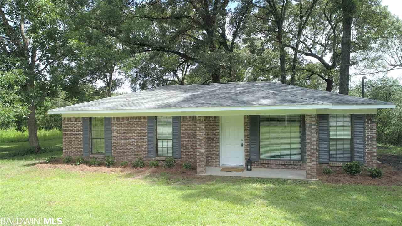 Looking to get out of a subdivision and away from HOA dues? Want to have some chickens, horses or some goats? This almost completely renovated 3/2 cottage out in the country on 2 acres is your ticket. Its only 5 miles from I-10 and the new Buc ee's.  New roof, new appliances, water heater, kitchen, baths, granite countertops, cabinets, stainless steel appliances and new flooring through out. Nice detached garage/workshop/storage building. Also bearing pear, blueberry, mulberry and a huge fig tree! This kind is hard to find, don't hesitate, it will be gone.
