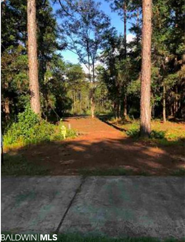 Location! Location! Location! South of the Grand Hotel and 2 miles south of County Road 32. South Fairhope - Scenic Heights Subdivision - good buildable lot with 90 frontage feet on Highway 98. Already been delineated! High and Dry and already prepped for you to build your DREAM HOME!