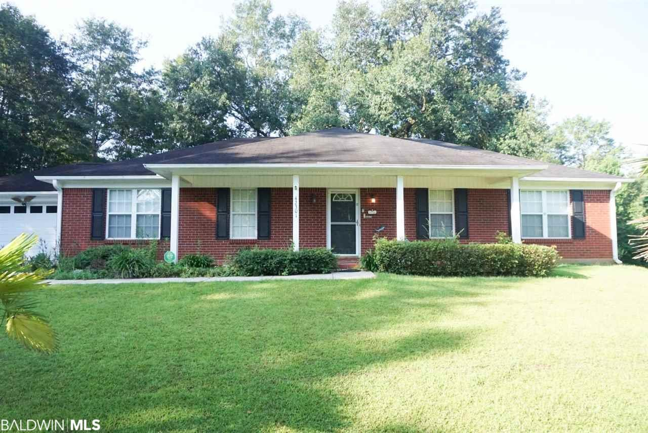 Immaculate and ready to move in! Grab this 3/2 home on approximately 1.39 acres! Features include open kitchen with eat in bar, breakfast room with bay window, separate office,/formal dining room, great room with f/p, split bedroom plan, raised ceilings, master bath with garden tub/ separate shower/double closets, tile and wood floors, trey ceilings in master, double sun rooms (one glass/one screen), storage building, 2 car garage and more! Estate home and priced to move!