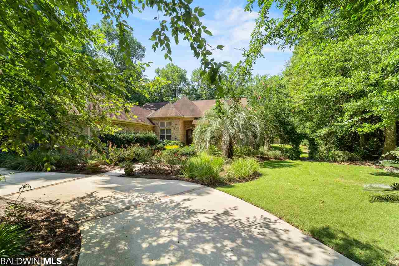 Custom-built LUXURY home in the heart of Old Daphne.  Great room with 14 foot ceilings, 6 foot tall mantle and fireplace, and oversized glass pocket doors that completely open to a private, professionally landscaped backyard, including a saltwater Gunite pool protected by a mosquito and leaf barrier, jaccuzzi, outdoor kitchen, wood burning fireplace and outdoor shower.   Split floor plan with large master bedroom suite overlooking pool and lush, private backyard oasis. Walk-in closet and large master bath with jetted tub and separate shower.  Three additional bedrooms on the other side of the home provide privacy for all. Cherry kitchen cabinets with stainless Wolf stove, beverage cabinet, built-in microwave and granite counter-tops.  Built-ins galore.  Formal dining room, private study, two car garage and more. Separate air-conditioned and heated cottage in the backyard with sink makes for the perfect artist studio or exercise room. Irrigation system on a well to water the beautiful, mature plants and trees. Walk to the bay, Bayside Academy or Christ the King.  A must see!