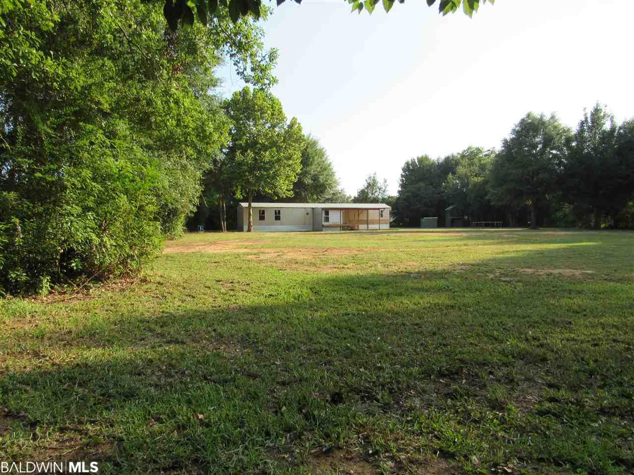 Two acres with a 980 sq. ft. modular home in rural Foley. Large 26x12 living/ kitchen/dining room combination. 756 sq. ft. metal      building/garage is almost new, with water and power. Two-story children's playhouse. Property entirely fenced. Seller open to owner financing with 20% downpayment. LISTING BROKER MAKES NO REPRESENTATION TO SQUARE FOOTAGE ACCURACY. BUYER TO VERIFY.