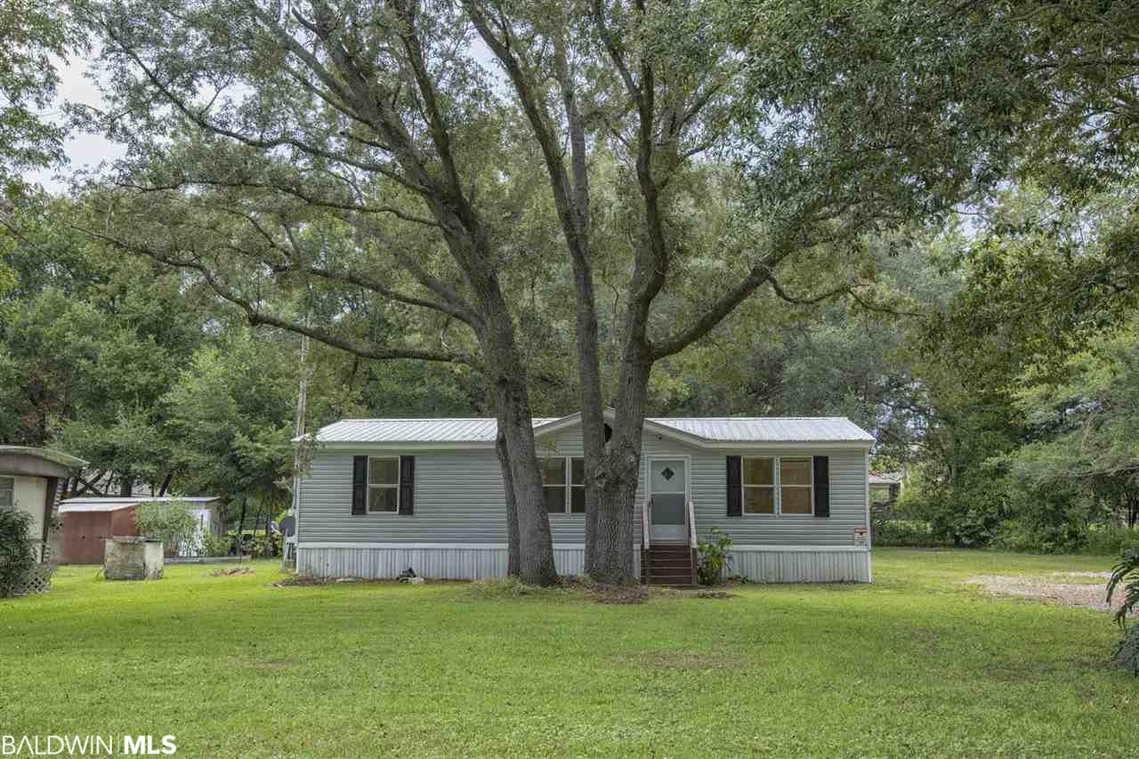 This is a BANK OWNED property.  Buyer's Agent to verify. Water is from Perdido Water and Riviera Utilities. Perfect starter home or investment property.  Refurbished mobile home in convenient area.  Large oaks.