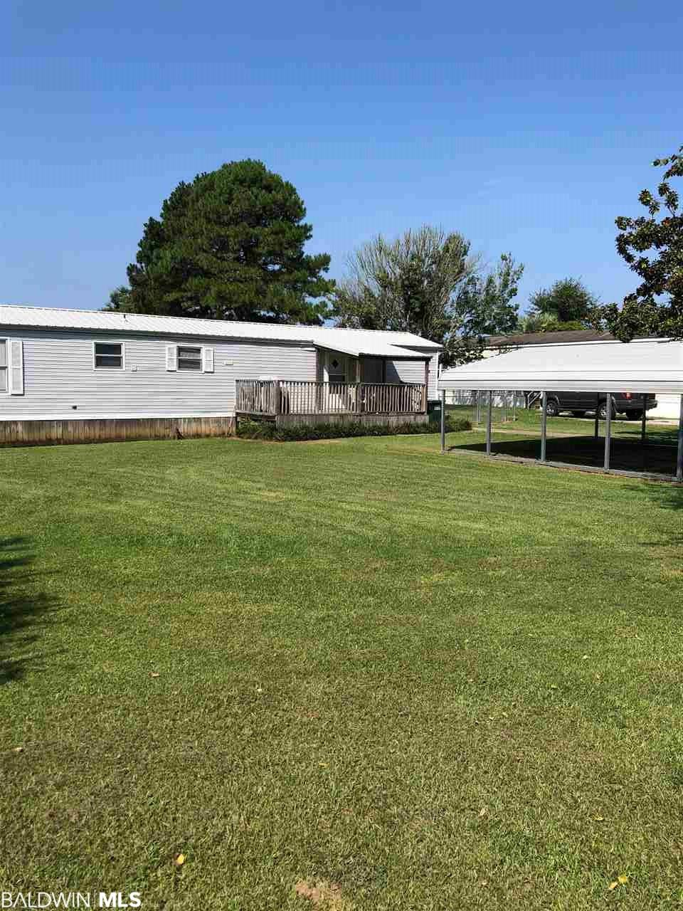 Move in ready in Fairhope! Walking distance to J. Larry Newton school! This 3 BR 2 BA mobile home is situated on a very large fenced lot at the end of the cul de sac. Fido or Fifi will love being able to run and run in their super huge back yard, and the kids will enjoy having plenty of room to play outside as well! Mom and dad can enjoy morning coffee on either the front or back porch, and dad will love the 10 x 12 shed that conveys with the property! Call me, or your favorite agent for an appointment to view this listing! Don't miss this wonderful opportunity to own your own home in Fairhope for $70,000!