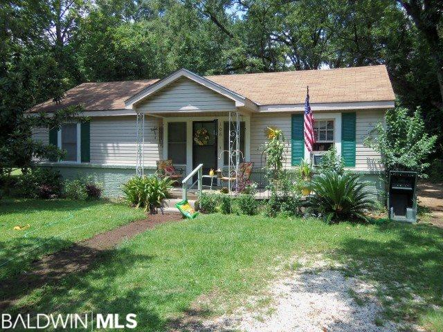 Investors and renovators take notice!  Cute, older cottage in great location right in the heart of Bay Minette.  Close to schools, hospital complex, and downtown.  Shady, level lot just a half block off of Hand Ave., and just a couple of blocks from new Bay Minette Elementary school.  Home is a prime candidate for some updating/renovating with lots of potential for a talented handyman.  At this price, this one shouldn't last long!  Call for a showing today.