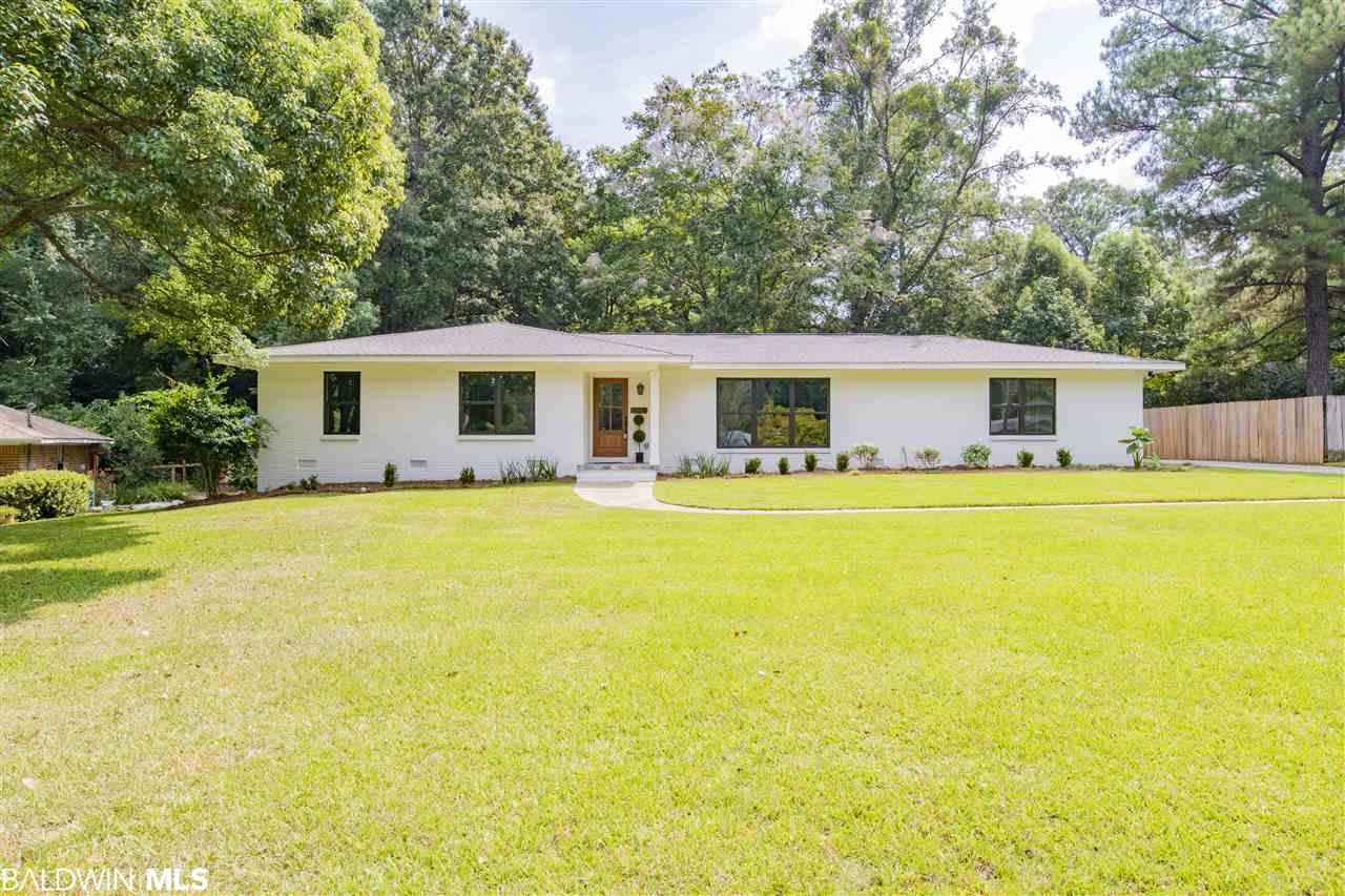 Fabulous move in ready 4 bedroom/ 3bath home in downtown Fairhope under $400,000! This home is practically brand new, it is even GOLD FORTIFIED! New roof, HVAC, windows with hurricane screens, floor system, electrical panel and service, the entire house has been brought up to 2019 code. On top of all this it is BEAUTIFUL!! Open floorplan with painted kitchen cabinets and quartz countertops, master suite with two closets and a gorgeous bathroom including separate shower, stand alone tub, and double vanities. Completely repainted inside and out, new flooring, split bedroom plan, renovated bathrooms, fenced backyard all tucked away on a cul de sac. You just don't find a house like this downtown at this price point!