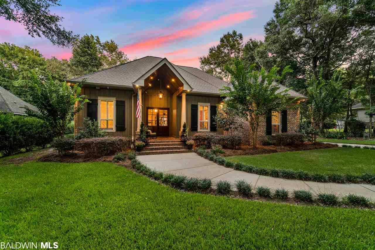 Located in the prestigious Woodlands at Fairhope, this immaculate custom one-owner home sits on 1+ acre and is an entertainer's dream! Almost all of one level, this property is 3800 sq ft and offers 5 bedrooms, 4 bathrooms, bonus room, and a covered patio that can be screened or completely enclosed (via electric vinyl screen) for extra living space with wood-burning fireplace with gas starter. Open floor plan. Tall ceilings. Engineered wood floors throughout living areas. Split bedroom plan. The kitchen is the heart of this home with an oversized granite bar accommodating space for 9 barstools as well as an island with space for 3 more barstools. Stainless steel appliances to include an electric cooktop (gas hookup as well), wall oven, GE Advantium microwave, ice-maker, disposal, black ground granite sink, loads of cabinets with spice rack pull-out, lazy Susans and more, and huge walk-in pantry! Master Suite offers a large walk-in closet with built-ins, double vanity, jacuzzi tub, shower, sep. toilet area. Bedrooms 2 and 3 share a bathroom. Separate bedroom suite on opposite side of house. Upstairs features a bonus room with a theater system as well as a bedroom/bathroom. Plumbed upstairs for kitchenette. Tons of storage inside as well as in attic! Plantation shutters on front of house. Surround sound. Attached 4 car garage (2 tandem spots) with utility sink inside garage. Detached double garage currently a workshop. Greenhouse behind garage. Outdoor kitchen area with sink, cabinets, & gas line. Beautifully landscaped! Courtyard off patio with iron fencing and decorative gate includes large fountain & 4-hole putting green. Storm ready: generator ready, plug-in ready for Master Bdrm window A/C unit, working shutters. 2 HVACs w/clean air filter system. 2 Tankless gas water heaters. 4 water hydrants stubbed in yard. 2 water meters--separate one for yard. Entire house replumbed in 2017. Alarm system with cameras. Built by Robert Nall, Bayside Builders.