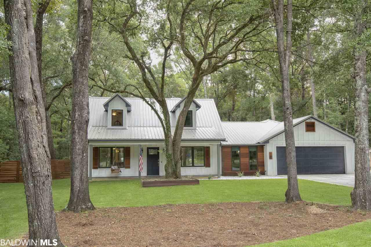 Award winning designers home 1 mile from downtown Fairhope.  This is a must see to believe!!  TWO custom designed gourmet kitchens. One with all high end appliances, and amazing in cabinet features.   This amazing home has everything you would want even privacy backing up to gully way with a total of 1.17 acres.   * Bosch oven and a micro/steam convection oven.  * Bosch dishwasher * Gagganeau built in coffee/espresso machine  * Electrolux state of the art induction cooktop  * Cambria Quartz countertops  *Sunroom/Movie room with 8' Pella 350 Hurricane Impact windows. * Wet bar with Uline wine fridge and Electrolux Ice maker *Custon Wood Pizza Oven  * One bedroom In-law suite/apartment has full kitchen, handicap bathroom with   wheel chair roll in shower, and full concrete drive with separate entrance. All   with honed granite and marble tops.   Great for income producing!!! *Upstairs are 2 large bedrooms and an amazing bathroom  *Fenced yard with plenty of room to add a pool.   *Fresh sod in front yard. *Tankless water heater. *Steam sauna shower in master bath. *Walk in closets.  *Bamboo & luxury vinyl plank flooring  * New metal roof * Stainless steel cable handrail system. * Tremendous custom built in laundry system with real cherry butcher block counters. * All new 400 amp electric service  The list goes on!  Seller offering $5000 landscape allowance!