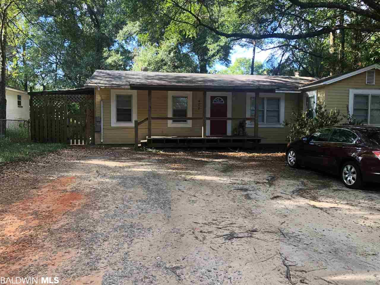 On a quiet street in the city of Fairhope is where you find this adorable ranch style home.  Minutes from the Water and Downtown Fairhope. Large backyard with a spacious shed. Great starter home or investment property.