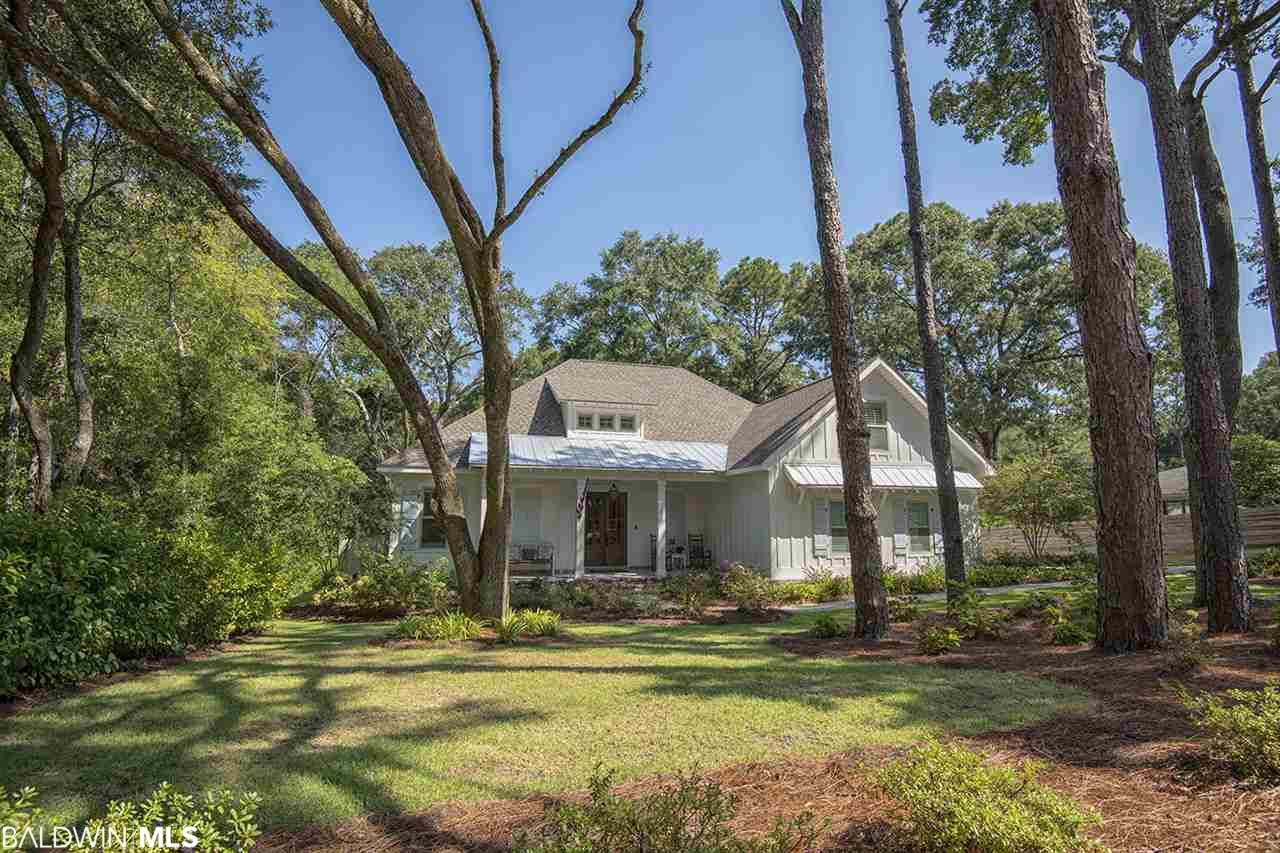 Dreams are coming true; this home is waiting for you! This gorgeous, custom home has everything! Walk or Golf Cart to downtown Fairhope or Mobile Bay. This home is located on a peaceful, quiet street tucked away on a meticulously landscaped and manicured lawn overlooking Tatum Gulley. Old and new elements combine to make this home timeless; you will be wowed by the  reclaimed brick entry way and wooden beams contrasting with modern features and a soothing color palette. Big enough for your family and friends, this open concept home is perfect for entertaining. High ceilings give presence and grandeur. Relax in your spacious master bathroom that attaches directly to laundry for warm towels fresh from the dryer! Cook meals in the fully outfitted chef's kitchen complete with gas range and enough storage for all of your gadgets and spices. Separate office/study and  large bonus/game room upstairs along with bedrooms and a Jack and Jill bathroom. Outdoor area lures you into a dreamy swing bed overlooking the natural and private back yard. The perfect location for shady dog walks and bike rides, this home has it all! Schedule your showing today!
