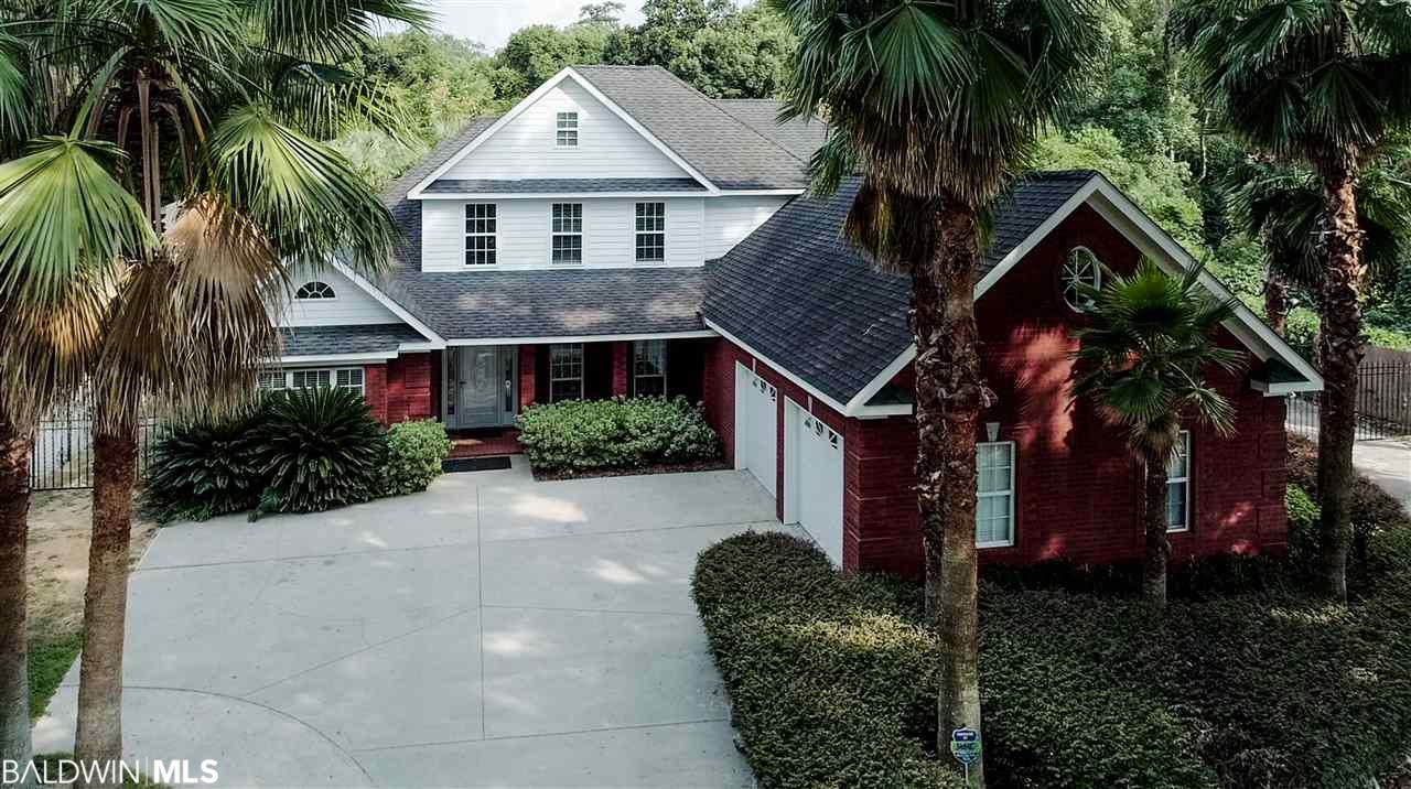 """Walk to downtown Fairhope and Fairhope Pier from this beautiful brick home. Don't expect """"run of the mill"""" when you see this property. You will find soaring 20'+ ceilings in the foyer and family room that give the home a bright and open look. The first floor master has a large sitting room and a fireplace. There is a rec room on the main floor that would be perfect for a pool table and a great playroom for kids. There are beautiful light laminate floors throughout the foyer, family room and master bedroom. The kitchen area, breakfast area, rec room, and laundry have tile floors. There is new carpet in the first floor bedroom and all carpet upstairs has been professionally cleaned. There is a large bonus room upstairs that can double as a 5th bedroom. There is access to the walk-in attic space in the bonus room. Double ovens and gas range in spacious kitchen. Seller says bring all reasonable offers."""