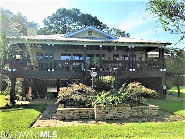 This Exquisite Fish River WATERFRONT Home offers 98' of river frontage with panoramic views. You can enjoy living on the water and relaxing right from your own porch overlooking the river and the beautifully landscaped lawn. Indoor features include a split floor plan, formal living room with cozy fireplace, spacious open kitchen with granite counter-tops and stainless-steel appliances. Each bedroom has its own private bath. Boating, fishing, and lots of other water activities are all part of this slice of paradise. There is a Guest House (336 SqFt) located over the boathouse that includes a studio/loft with a small kitchen and a deck. This property features a boat house with electric boat lift with remote, PWC lift, bulkhead, covered parking, a jet ski lift, sun and swimming deck, and plenty of storage. New HVAC in main house and guest house, Main house and guest house has recent re-plumbing with Uponor Aqua Pex Plumbing System, All hardwood floors refinished, Kennel with fenced area on side yard, Extensive drainage system in the yard to prevent any river flooding. Move in Ready!!! Call today to schedule your tour!!!