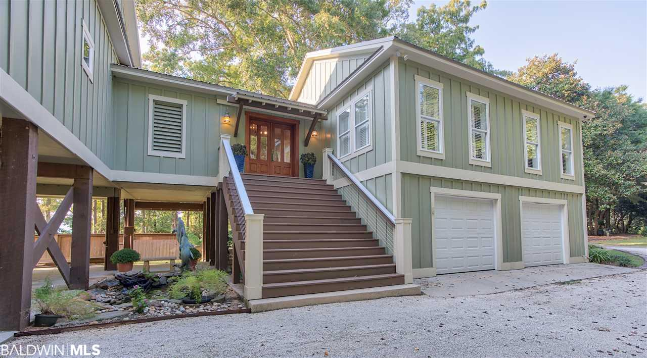 "Tucked at the end of Bayshore Drive in the Historic Montrose area sits a stunning waterfront home offering panoramic views of beautiful Mobile Bay. It is regarded as one of the best locations in the area to experience the phenomenon known as a ""Jubilee."" Enjoy the easy-going bay lifestyle of the Eastern Shore with this 100' lot with a white, sandy beach. This home is well-crafted and offers many thoughtful design features including a chef's kitchen complete with inlayed cabinets, quartz counter tops, subway tile backsplash and Subzero and Wolf appliances. The beautiful heart pine floors are quintessential southern design as are the tray ceilings and large outdoor living spaces. Overlooking the bay is a master bedroom retreat which offers a soundproof, spa-like oasis in addition to his and hers closets and a sitting area. The main floor has two additional bedrooms, a full bath and a half bath, lots of storage areas and many built-ins. Upstairs you will find a large game room, a bedroom and a bath with stunning bayfront views. The upper screened in porch is expansive with an outdoor kitchen and plenty of room to entertain and relax. The yard is large, flat and beautifully landscaped and leads to a sandy beach and wharf. The wharf was constructed by well-known contractors, Cassidy Brothers Construction, and offers boat and jet ski lifts and ""flow-through"" decking. Other details include a metal roof, 2x6 exterior walls, silent floor joists, solid plyboard construction, and a well for irrigation. In addition to the two-car garage, there is abundant parking for cars, golf carts, kayaks and bicycles. Welcome to forever sunsets and a place you will never want to leave. For a complete list of features, please contact agent."