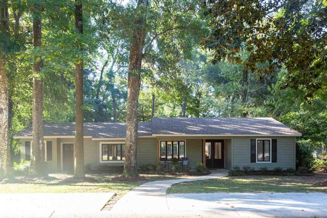 Exceptionally maintained and updated in the heart of Old Town Daphne.  This property is a one level split layout Coastal Craftsman Ranch with a massive amount of natural light coming in from every window.  The inside of the home has fresh paint, new custom crown molding in the living area, beautiful split brick floors and large windows that open up onto an oversize wooden deck that is first class for entertaining.  Home also has a 24 x 12 bonus room with a tongue and grove ceiling and new carpet.  It could easily be converted into a 4th bedroom if the need arose.  The exterior of the home is wrapped perfectly with low maintenance hardy board siding that has been completely finished with a fresh coat of paint.  New roof in 2018. The attic has spray foam insulation which keeps the electric bill close to 200.00 even in the hottest months.  New central A/C unit (1 year old). All plumbing was replaced in August of 2018.  The lot is huge, flat and very private, with plenty of trees that provide shade and a Utopian space to relax.  This home is also located in very short walking distance to the bay or all of the schools in Old Town Daphne.  Come experience first hand why people are flocking to OTD and loving the Old Town lifestyle!