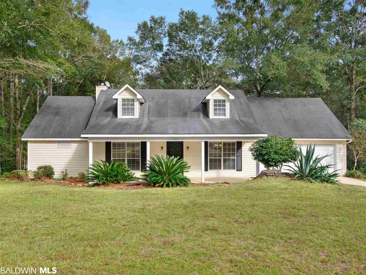 This well designed home has everything and is ready to move right in.  Located in Plantation Hills subdivision this property is open and spacious.  The downstairs has a large great room that is accented by a painted brick fireplace. and great views of the back yard and deck.  Just off the great room is the morning room that leads into the kitchen and has large windows that allow in natural lighting. Custom tile floors make this an easy house to clean and maintain. The kitchen comes with Stainless Steel appliances, loads of cabinets and storage.  Just off the kitchen is the double car garage and utility room.  The upstairs is well designed to include multiple bedrooms and a bath as well as storage for all of your stuff.  Outside is a nice front landscaped yard and the in the back is a multi tier deck, a separate doll house storage shed and a lot of room for the pets.  Located in the Spanish Fort school district, close to shopping, medical facilities and I-10 for a quick ride to both Pensacola, Fl and Mobile, Al. The house is super easy to view and available for immediate occupancy.