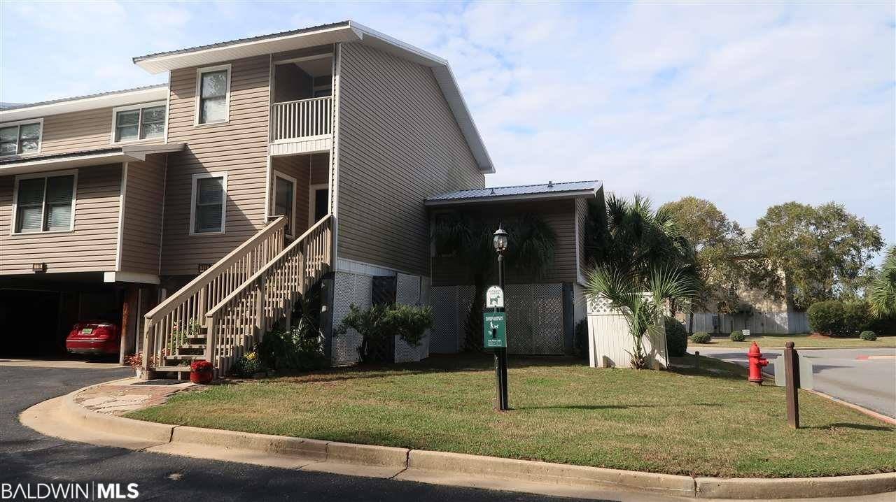 This is a spacious3 bedrooms, 3 baths Condo with views of Mobile Bay from both balconies, boat launch, covered parking, workshop etc.  The Master bedroom is on the Main Level with a small office area.  The 2nd master bedroom is upstairs with separate balcony.  The Ship Lap ceiling in Dining Room set the nautical theme for the perfect condo overlooking Mobile Bay. The kitchen is large with separate breakfast area , Granite Counters, Wooden Cabinets with drawers, Stainless Steal Appliances, Smooth Cooktop, Built in Oven, Dishwasher with extra features.Great location, 1 mile south of I-10 and 9 miles from downtown Mobile.  The low HOA fee is wonderful .  The metal roof is less than 1 year old.  New H/A unit,  owner is furnishing a Home Warranty on this condo that is in excellent condition.