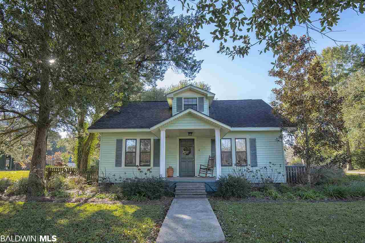 If you're looking for a quaint, cozy home in a great location, look no further.  This home, originally built in the 1920's, is 2000 square feet. Two bedrooms and a bath are located upstairs while the remaining two bedrooms and another bath are downstairs. It sits on a large lot with mature trees, St. Augustine grass, attractive landscaping, and a fenced in yard. Outside, you will also find a carport with attached storage room and a shed/workshop in the backyard. The inside has beautiful, original pine hardwood floors, adding to the character.  Over the years, it has had additions and updates including a central heat and air unit that is only two years old. However, it still maintains its charm and character. Original and unique, this property has much to offer!