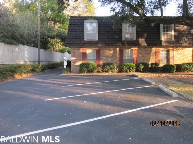 Excellent Location, 1st Level, End Unit faces Mobile Street. One Assigned parking space just outside bedroom window at front of Complex. Coin-op Laundry room on-site. Complex is across the street from the bay, Walking distance to Fairhope Pier, Orange Street Boat Ramps, and Pecan Street Pier.
