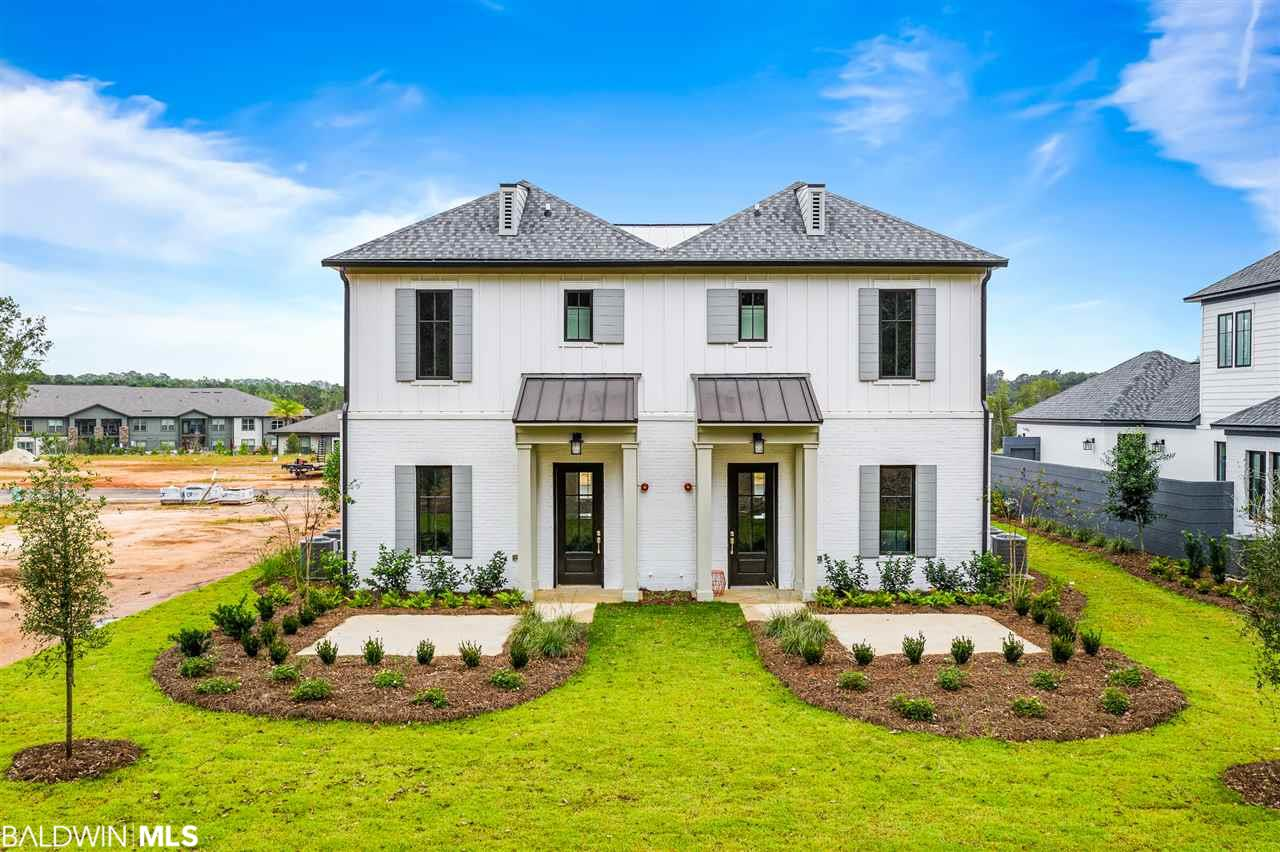 The Highlands at Fairhope Village are here and ready for you!  Townhomes are 3 bedrooms and 2.5 baths with beautiful surroundings and ideal Fairhope location. Top of the line finishes, stainless appliances and architectural details. This is an upgraded townhome with wood flooring, ship-lap wall in living area plus more. Let the Highlands of Fairhope Village be the next place you all home.
