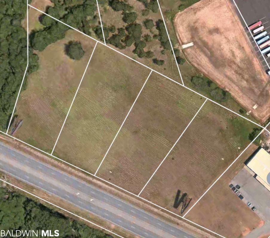 Awesome Commercial Acreage on the EXTREMELY BUSY Highway 59!  With 507 feet of direct road frontage on Highway 59N, the mostly clear land is situated just south of the town of Loxley, AL.  In addition, the 4.25+/- acre parcel has already been subdivided into 4 separate 1+/- acre lots and is approximately 2 miles from I-10! Listing price includes lease income from 2 separate billboard structures located on the property. The lease agreement for these billboard structures is now able to be re-negotiated by the future owners of this parcel...DO NOT DELAY IN HAVING A SAY on the future lease agreement for these structures.  With all utilities readily available, this land lacks only one thing...an investor/developer with the vision to bring out its FULL POTENTIAL!  Call today, your clients will not want to miss out on this amazing opportunity!  Buyer/buyer's agent to verify all measurements and relevant information.  ***Must submit offer on BCAR purchase agreement***