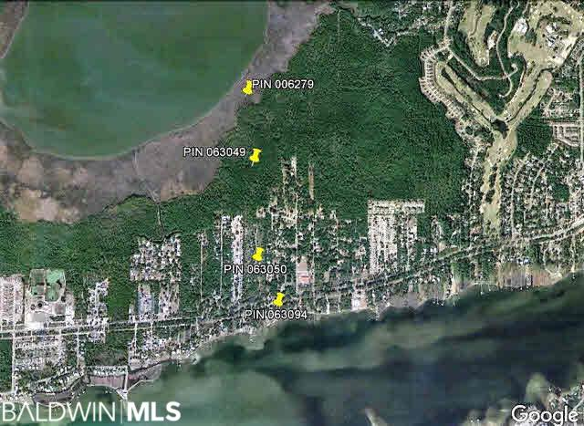 Great development opportunity in Gulf Shores. These 4 lots offer a unique opportunity for possible development on the north side of Little Lagoon. PIN 063094 is approximately 5.56 +/- acres on Little Lagoon with approximately 790 +/- feet on the north shore of Little Lagoon. Also included is PIN 006279, 063049, and 063050. These 3 parcels are located on the Northside of Ft Morgan Road slightly adjacent from the parcel on Little Lagoon. The 3 northern parcels consist of 45 high elevation acres that are connected and have approximately 246 +/- feet of road frontage, along with 9.5 acres on Oyster Bay. Great development opportunity to consider connecting these parcels into one comprehensive project.