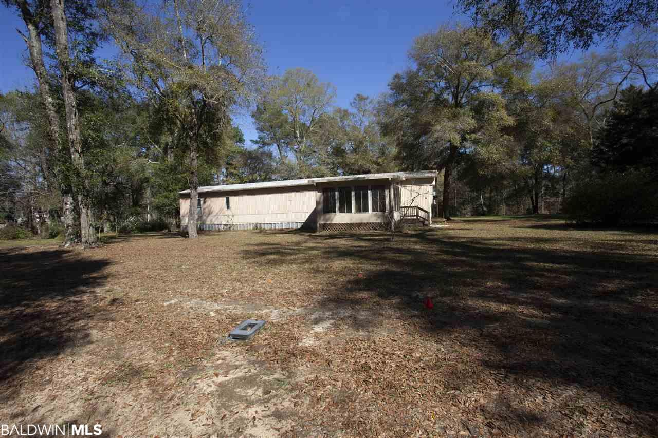 Small Mobile home on beautiful 3 acres. Gorgeous flowers and abundant fruit trees. A stream runs along the back of the property and is 1.5 miles from the public boat dock and public beach access. A must see hideaway in Fairhope.