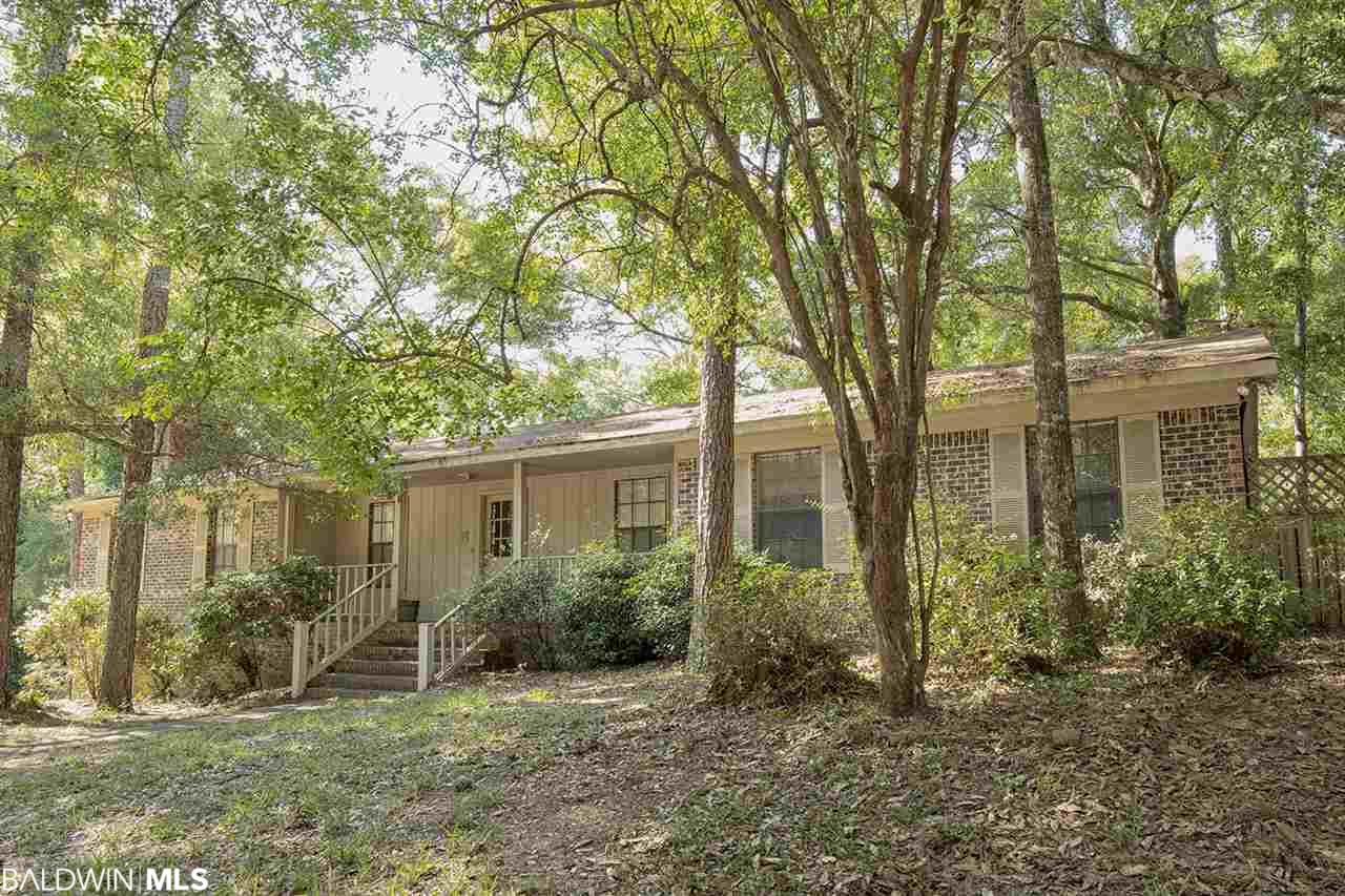 Nice brick 4/3. Corner lot. 4th bedroom and 3rd bath downstairs. Open porch-fenced back yard.  Beautiful fireplace.