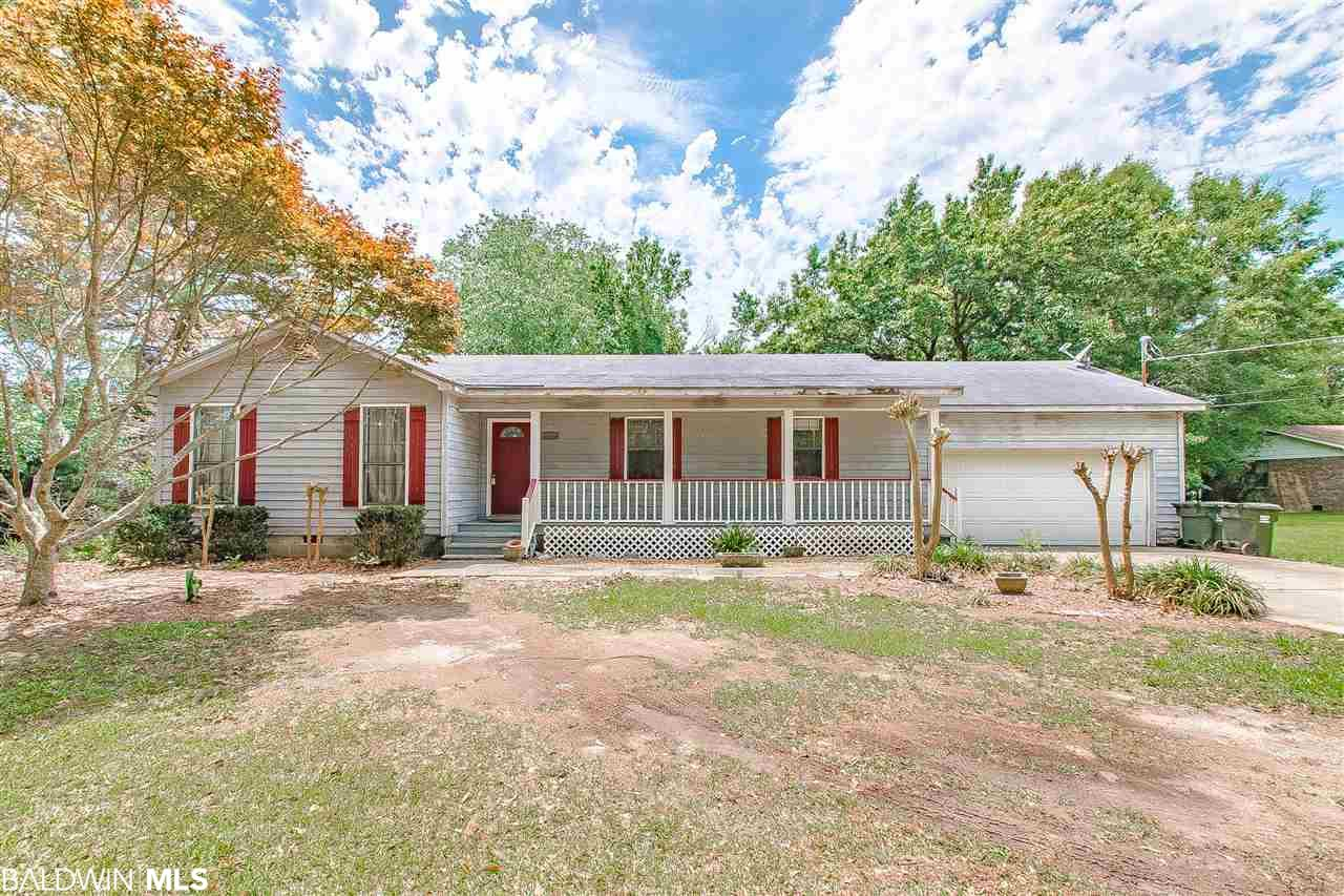 """Country home that sits on 1.06 Acres of land in Fairhope. This 3 bedroom 2 bath home just needs your personal touch to make it your home. Large kitchen with island eat in kitchen combo. Located minutes from shopping. AC is only 3 years old! Home is being sold """"As Is""""  Don't miss out on this rare find in Fairhope, contact you favorite realtor today!"""