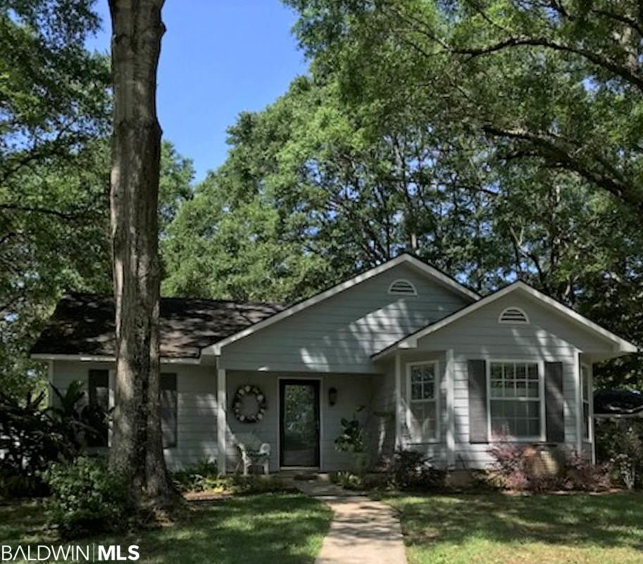 Precious Cottage on a corner lot with large oak trees.  Large 12' X 24' shed in back with A/C.  Split bedroom plan- completely updated with LVT floors; new paint, also.  Granite countertops in kitchen.  Fenced-in back yard; patio area by carport; A/C 5 years old.    LISTING BROKER MAKES NO REPRESENTATION TO SQUARE FOOTAGE ACCURACY. BUYER TO VERIFY.