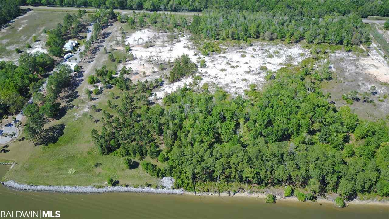 Excellent shovel-ready waterfront development opportunity in Gulf Shores! Over 20 acres on the Intracoastal Waterway zoned for 20 units per acre. 800' Intercoastal Waterway frontage, deep water. Permitted for 56 large boat slips. Property fronts County Road 4 in Gulf Shores. Listing includes PPIN #'s 029387, 345107, and 345108.