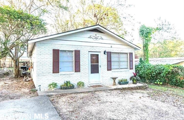 EXCELLENT LOCATION!!! NEWLY PAINTED EXTERIOR! This Adorable Cottage is within walking distance of Downtown Fairhope! Enjoy all the festive activities and unique dining and shopping opportunities that Fairhope has to offer! Also, Mobile Bay is a short drive with magnificent sunsets and refreshing bay breezes.  Upon entering the home, you're greeted by the quaint living room, complete with wood burning fireplace, perfect for chilly evenings by the fire! To your left is the dining area, kitchen & indoor laundry room. Follow the hallway to 3 spacious bedrooms, guest bathroom and Master bath. The home has a spacious backyard with storage shed that conveys. Recently painted interior, Newer roof, AC replaced in 2014. Property has a great rental history! Call Today!