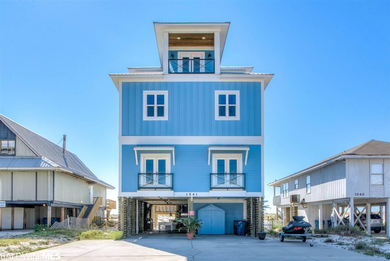 Treasure found on sought after West Beach in Gulf Shores. Perfect blend of functional & beautiful awaits you in custom home built by Compass Construction. Rustic/industrial split cedar log stairway entrance invites you into main living area w/ glistening knotty pine floors, large windows & high ceilings which inspires you with a full view of the beach. Who does not appreciate a gourmet kitchen with Gulf & Pool views?  40-inch stainless gas stove w/ double oven & its custom vent hood and pot filler sits centerstage surrounded by granite & white cabinets. Separate refrigerator and freezer units accommodate large groups for food prep & storage. 2 dishwashers & 20lb icemaker keeps everyone happy.  8 bedrooms with additional bunks in office.  2 located on the main level, 5 on the 2nd level, & master and office on the 3rd.  Heated swim spa and hot tub located on first deck. Gulf front decks on level two and three.  Outdoor shower under house and entertainment area with pool table, foosball table, stone table for 6, and workshop completes the home. LISTING BROKER MAKES NO REPRESENTATION TO SQUARE FOOTAGE ACCURACY. BUYER TO VERIFY.