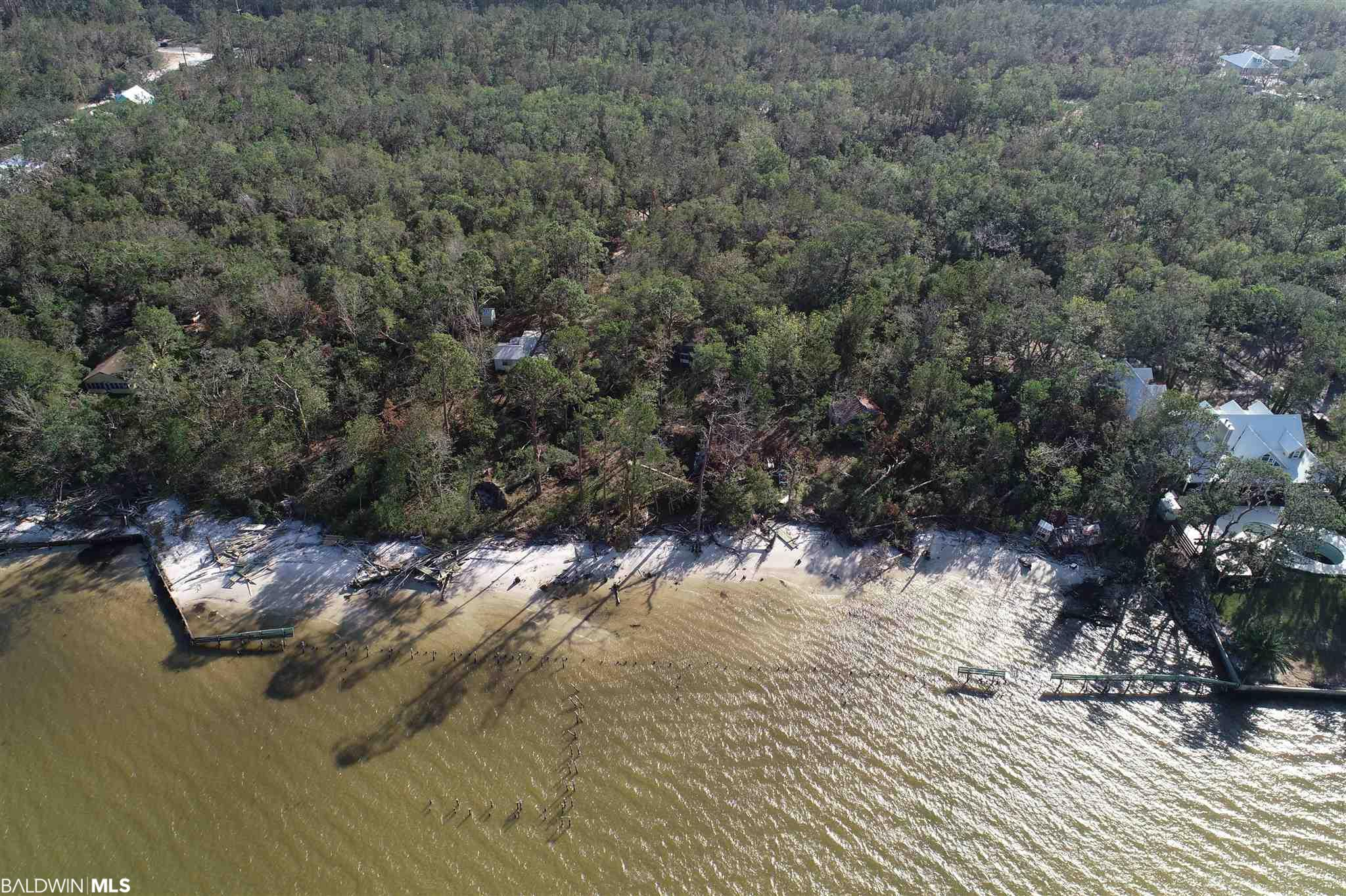 RARE OPPORTUNITY TO OWN 15.5 ACRES ON BON SECOUR BAY!  Family has decided it is time to sell the land that has been in their family since the 1850s.  There are 5 parcels that provide 895' waterfront on Bon Secour Bay and 891' road frontage on Ft. Morgan Rd.  The property is heavily wooded and the bulk is designated as a Code X Flood Zone.  There are no wetlands on the property nor beach mouse habitat.