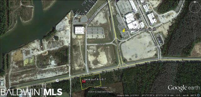Zoned General Business. Located at the intersection of Canal Road and The Wharf Event Center & Beach Express. Views of the Intracoastal Waterway. Steps from the Event Center & the amphitheater. 4.5 Miles to the beaches. 105 Miles to Orange Beach Sportplex. 6 Miles to the Heart of Gulf Shores.15,430 Average daily traffic count.