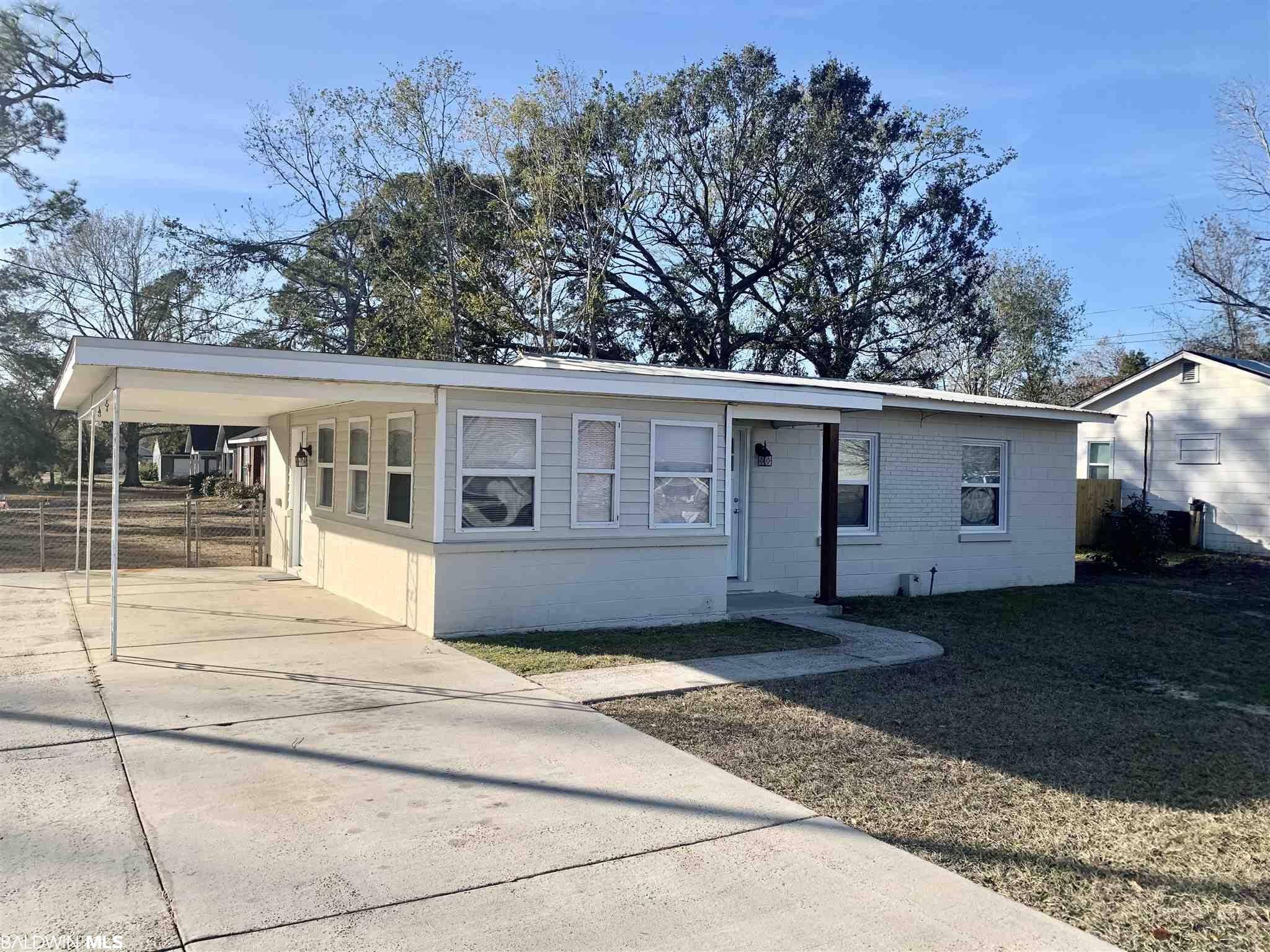Investor's delight or Starter Home!  CLEAN 2BR/1BA plus Sunroom or 3rd BR with Closet!   Tile flooring throughout, updated Kitchen, HVAC 5 years old, Hot Water Heater 3 years old,  Metal Roof, Single attached Carport, Outside Storage building, new Sod on a Corner lot.   Refrigerator and Washer & Dryer convey.  This one will not last long!  Previously rented for $850/month.   All information provided is deemed reliable but not guaranteed. Buyer or buyer's agent to verify all information.