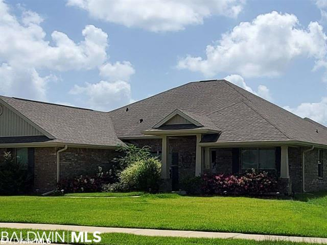 Beautiful 4/3 home in the well established and highly desirable Woodmont Subdivision in Foley. One story brick, corner lot built in 2016 with 2664 sq feet. Double garage, extra concrete pad for parking, granite in kitchen, sold with stainless steel appliances including inside refrigerator. Trey ceilings, master bedroom with 2 walk-in closets. Fenced yard, in-ground salt water pool and hot tub. Exterior recessed lighting, irrigation installed, lawn planted with low maintenance Palisades Zoysia. All pool cleaning equipment included. Interior and exterior furnishings and wall mounted televisions are negotiable. A great location, close to outlet stores, restaurants, OWA amusement park, and of course the beach. Close to Fairhope and excellent access to Pensacola and Mobile from this location.   LISTING BROKER MAKES NO REPRESENTATION TO SQUARE FOOTAGE ACCURACY. BUYER TO VERIFY.