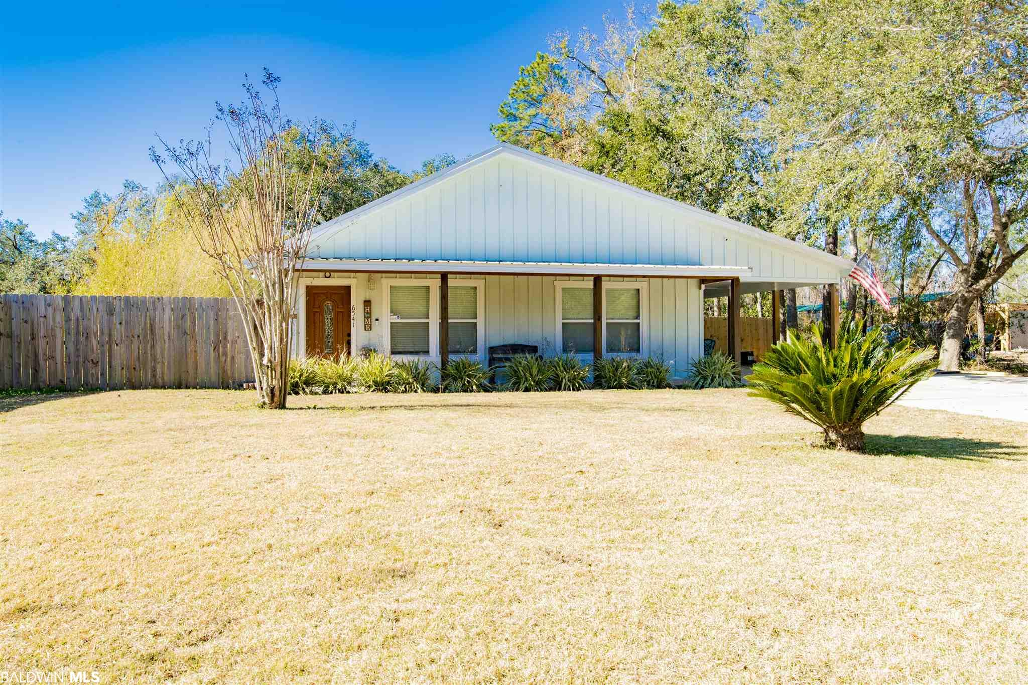 Do not miss out on this precious home in Bon Secour, located just minutes to Tin Top restaurant. Quiet country setting just minutes to Foley and Gulf Shores. This Spacious 2 bedroom, 2 bathroom home has new flooring, and a kitchen that features granite counter tops with stainless steel appliances.  The BIG fenced in yard is half an acre with a storage building AND a workshop connected to the back of the home.