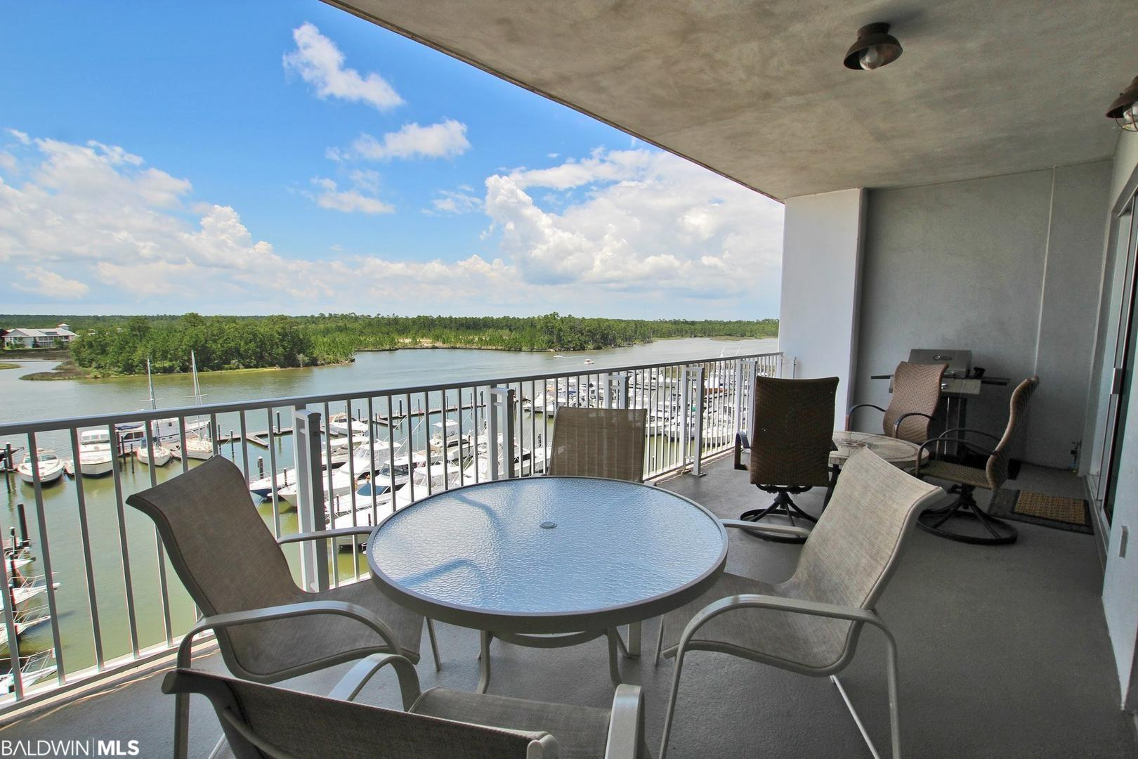 Most desired 2 bedroom 2 bath floor plan at The Wharf!!  Large rectangular balcony with 2 seating areas and natural gas grille.  Located on the East end of complex with beautiful views of the IntraCoastal Waterway. This 5th floor unit offers stainless steel appliances, granite countertops, and  2 large bedrooms with adjoining bathrooms. Enjoy the Oasis Waterpark during the day and Wharf Mainstreet at night full of shops, dining, and entertainment.  Excellent Rental history.  2019 rentals $32,862.45 New Refrigerator 2016. New Washer/Dryer 2016. New Gas Grille 2019. New 2nd Bedroom Furniture, TV Console and Living Room Chairs 2020.