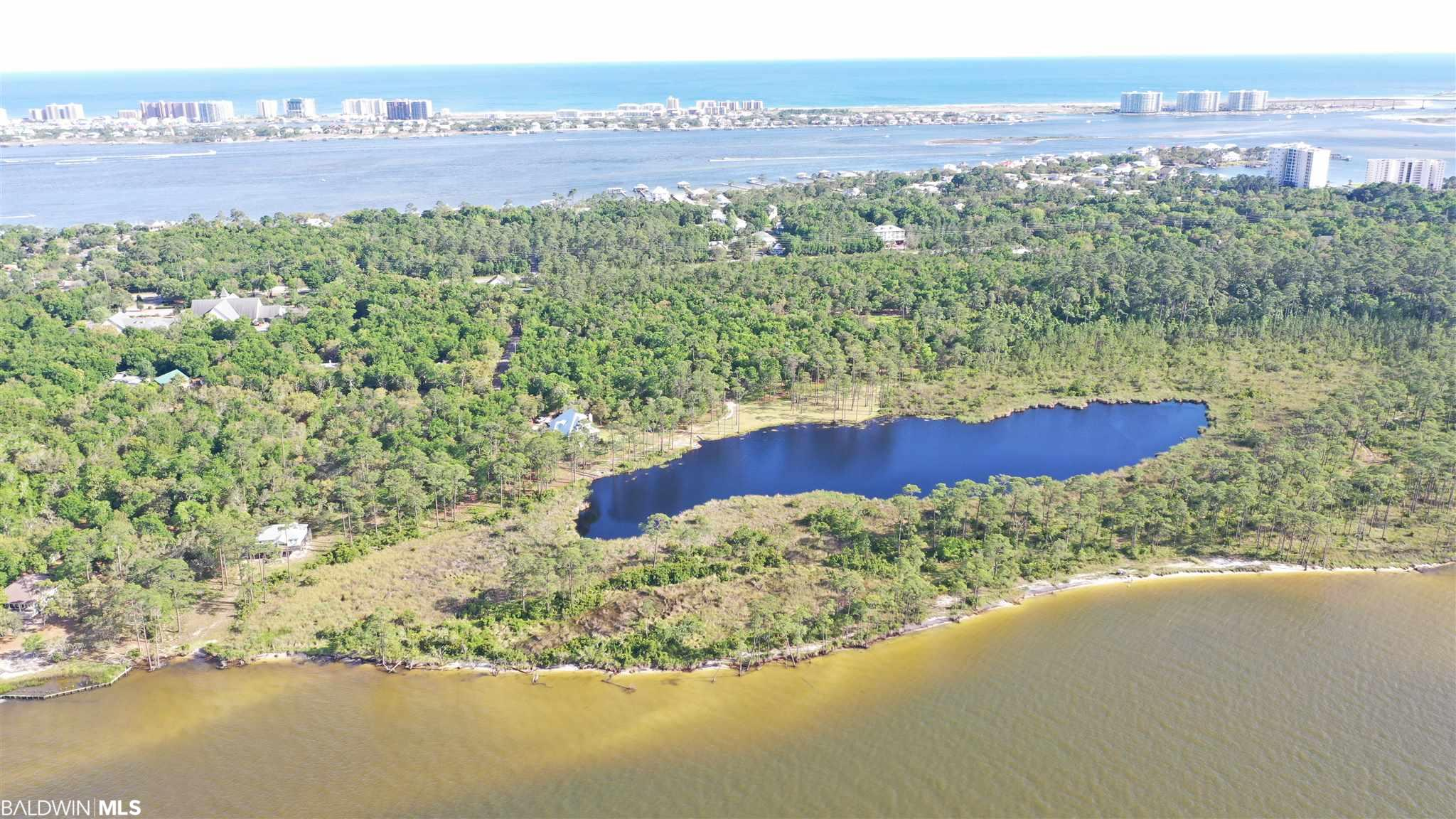 One of the last large jewels in Orange Beach offering approximately 45 acres with large lake in the center of the property and approximately 1700 front feet on Bay la Launch.  Beautifully wooded and incredible waterfront views.  Approximately 1100 feet on Canal Road.  Limitless possibilities on this one of a kind property.  All information provided is deemed reliable but not guaranteed. Buyer or buyer's agent to verify all information.